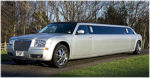 Chauffeur stretched silver Chrysler C300 Baby Bentley limo hire in Glasgow, Edinburgh, Scotland