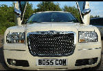 Chauffeur stretched cream Chrysler C300 Baby Bentley limo hire with Lamborghini doors in Birmingham, Dudley, Wolverhampton, Telford, Walsall, Stafford, Worcester
