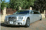 Chauffeur stretch silver Chrysler C300 Baby Bentley limo hire in Sheffield, Rotherham, Doncaster, Chesterfield, South Yorkshire
