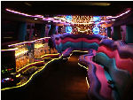 Chauffeur stretched pink Hummer H2 limo hire interior in Bristol, Gloucester, Cheltenham, Cardiff, Wales, Weston Super Mare, and Bath.
