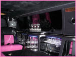 Chauffeur stretched pink limousine hire interior in UK